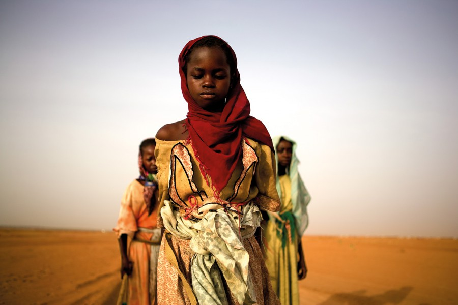 Young girls leave an IDP camp to gather firewood for their families. For some the work will take over 7 hours and lead them past government checkpoints and leave them exposed to attacks.
